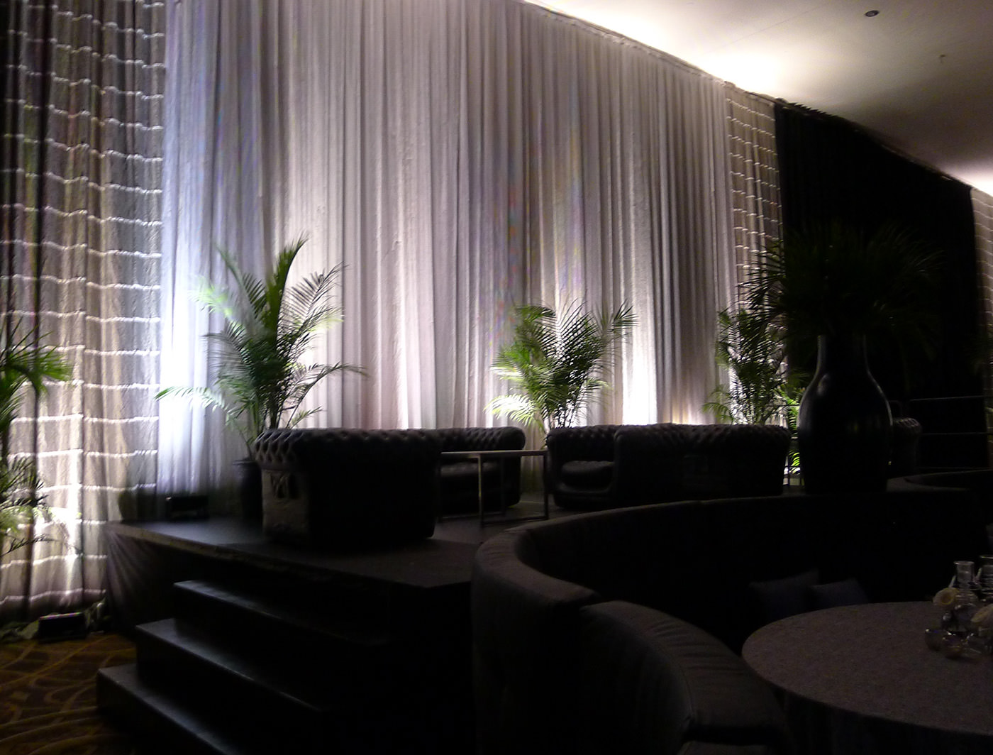 BLACK DRAPES WITH LYNES AND SILVET SHEEN CREATE AN ELEGANT BACKDROP AT THE SPECIAL EVENT CONFERENCE AND TRADESHOW 2013