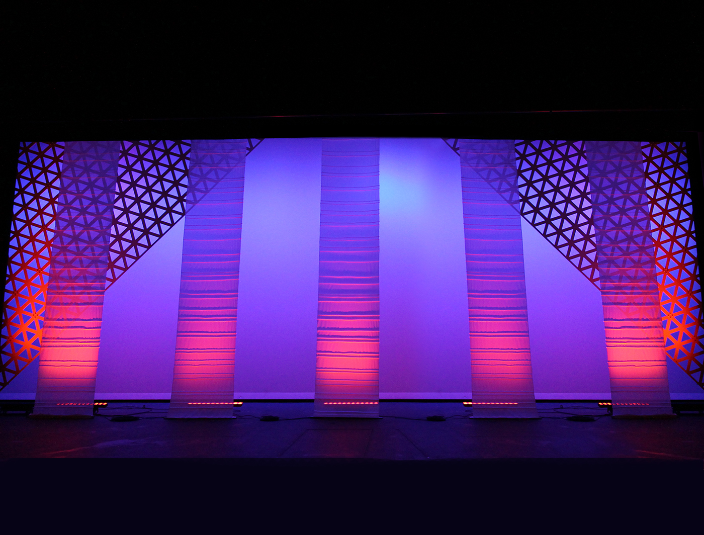 Tuck panels up light well onstage with Triad panels hung at a slant